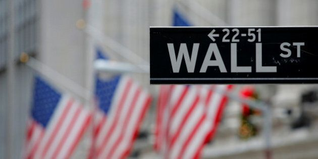 A street sign for Wall Street is seen outside the New York Stock Exchange (NYSE) in Manhattan, New York...