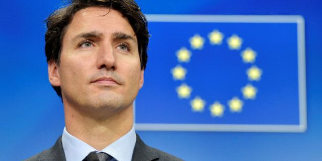 Canada's Prime Minister Justin Trudeau looks on during a news conference after the signing of the Comprehensive...