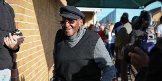 CAPE TOWN - SOUTH AFRICA - AUGUST 03: Archbishop Emeritus Desmond Tutu leaves a voting station after...
