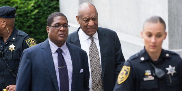 NORRISTOWN, PA - JUNE 15: Andrew Wyatt and actor Bill Cosby arrive at Montgomery County Courthouse as...