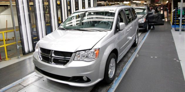 Chrysler Group LLC Dodge Grand Caravan vehicles move down the production line at Chrysler's assembly plant in Windsor, Ontario, Canada, on Tuesday, Jan. 18, 2011. Chrysler Group LLC, the U.S. automaker operated by Fiat SpA, will begin selling hybrid versions of its 300 sedan next year as well as of its next-generation minivan later, the companies' top executive said. Photographer: Jeff Kowalsky/Bloomberg via Getty Images