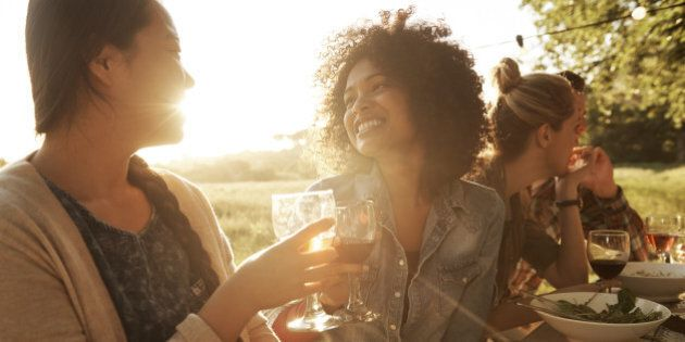 Shot of two women enjoyingthemselves at a late afternoon outdoor