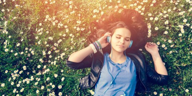 Girl lying down in the grass -
