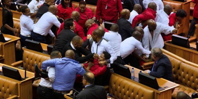 Economic Freedom Fighters (EFF, in red) party members of parliament are physically removed from the South...