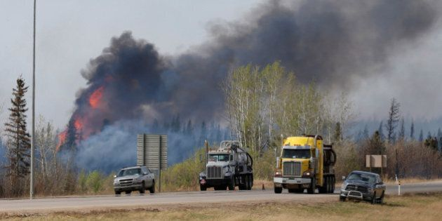 A wildfire burns near Highway 63 south of Fort McMurray, Alberta, Canada, May 8, 2016. REUTERS/Chris