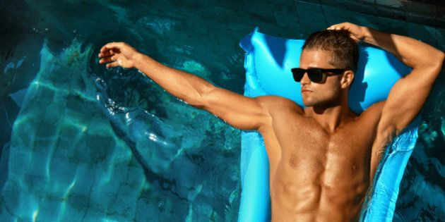 Man Body In Summer. Male In Pool. Beautiful Sexy Model In Fashion Sunglasses Tanning In Swimming Pool...
