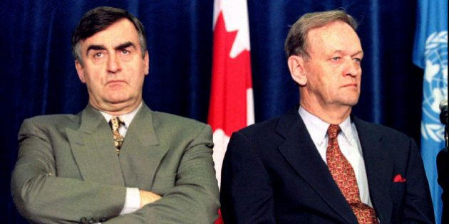 Quebec Premier Lucien Bouchard and Canadian Prime Minister Jean Chretien (R) sit together during the...
