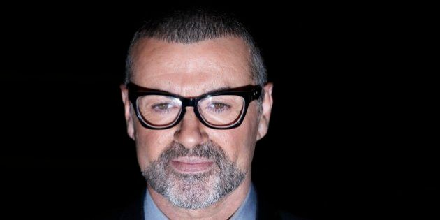 British singer George Michael poses for photographers before a news conference at the Royal Opera House...
