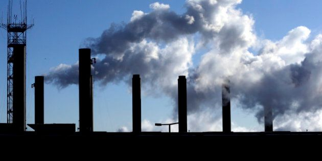 FILE - In this Jan. 7 2015 file photo, smoke emits from a factory chimneys near O'Hare airport in Chicago. The Institute for Supply Management releases its manufacturing index for March on Wednesday, April 1, 2015. (AP Photo/Nam Y. Huh, File)