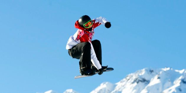 Canada's Mark McMorris performs a jump during the men's snowboard slopestyle competition at the 2014...
