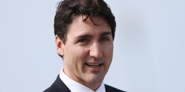 Canadian Prime Minister Justin Trudeau delivers a speech during his visit to Juno Beach on April 10,...