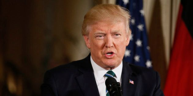 U.S. President Donald Trump speaks as he holds a joint news conference with German Chancellor Angela...