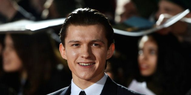 Actor Tom Holland poses at the premiere of the