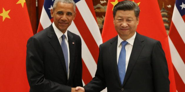 US President Barack Obama (L) and Chinese President Xi Jinping shake hands during their meeting at the...