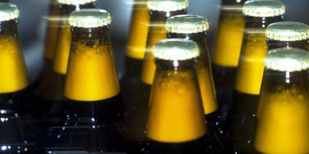 Bottles of Taller lager move along the production line at the OAO SUN Inbev beer plant, a unit of Anheuser-Busch InBev NV, in Chernihiv, Ukraine, on Friday, March 3, 2017. SUN InBev brews both national and international beer brands including Bud, Stella Artois and Corona. Photographer: Vincent Mundy/Bloomberg via Getty Images