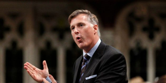 Canada's Minister of State (Small Business and Tourism) Maxime Bernier speaks during Question Period...