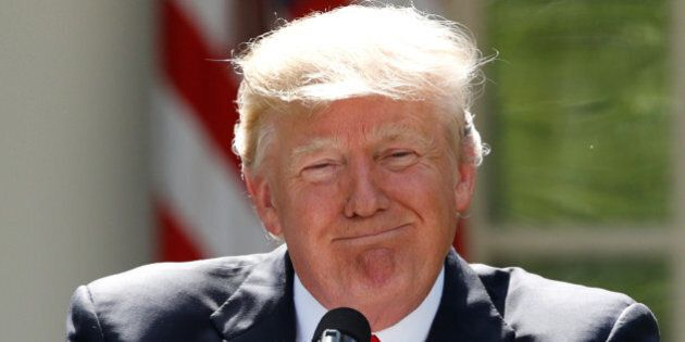 U.S. President Donald Trump pauses as he announces his decision that the United States will withdraw...