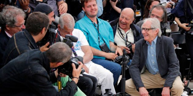 Director Ken Loach (R) jokes with photographers during a photocall for the