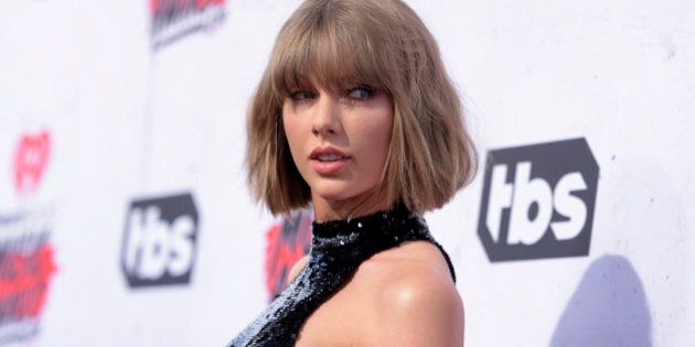 """FILE - In this April 3, 2016 file photo, Taylor Swift arrives at the iHeartRadio Music Awards at The Forum in Inglewood, Calif. Swift posted several pictures of herself as Marvel's Deadpool character alongside some friends on Instagram on Oct. 31, 2016. She thanked Deadpool star Ryan Reynolds in one caption, calling him """"the BEST deadpool inside contact ever.""""s (Photo by Richard Shotwell/Invision/AP, File)"""