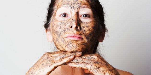 Mature woman making cosmetic mask from coffee, sour cream.