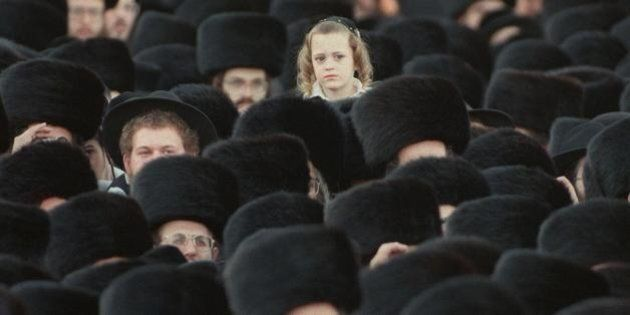 JERUSALEM:An ultra-orthodox Jewish boy is lifted up over a crowd of tens of thousands of Hassidim gathered...