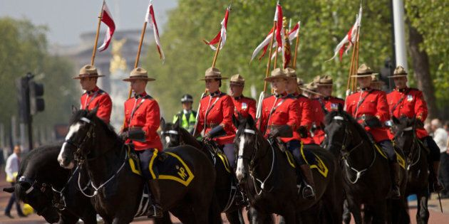 Royal Canadian Mounted Police (RCMP) parade down the Mall in central London, on May 23, 2012, as they...