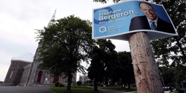 A campaign sign for Parti Quebecois legislator Stephane Bergeron is posted in the Quebec town of Varennes August 17, 2012. Less than two decades ago, in perhaps the most traumatic moment in modern Canadian history, the predominantly French-speaking province of Quebec came within a hair's breadth of voting for independence. And while another vote may still be years away separatist sentiment is back on the agenda as opposition party Parti Quebecois, dedicated to carving Canada into two, heads for victory in the September 4 provincial election. Picture taken August 17, 2012. REUTERS/Christinne Muschi (CANADA - Tags: POLITICS)