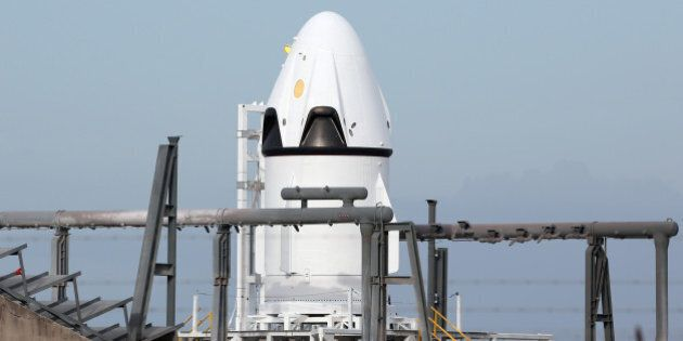 SpaceX's crew Dragon capsule is poised on a launch pad on Tuesday, May 5, 2015, ready for a test flight...