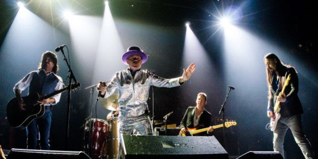 TORONTO, ON - AUGUST 10: The Tragically Hip performs on stage during 'Man Machine Poem' tour at the Air...
