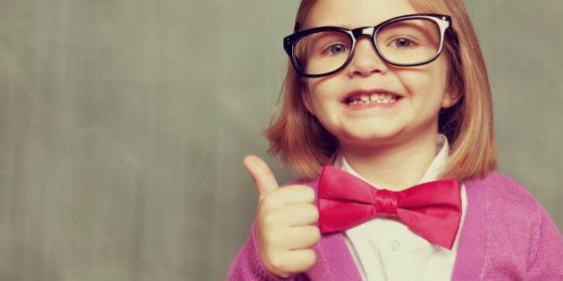 Portrait of a little nerd girl, ready to learn. Vintage