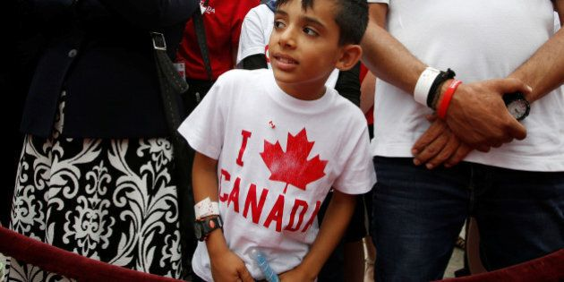 A Syrian refugee waits to shake hands with Canada's Prime Minister Justin Trudeau (not pictured) during...