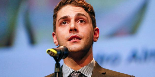 Canadian director Xavier Dolan delivers a speech during the 2014 Lumiere Film Festival prize in Lyon,...