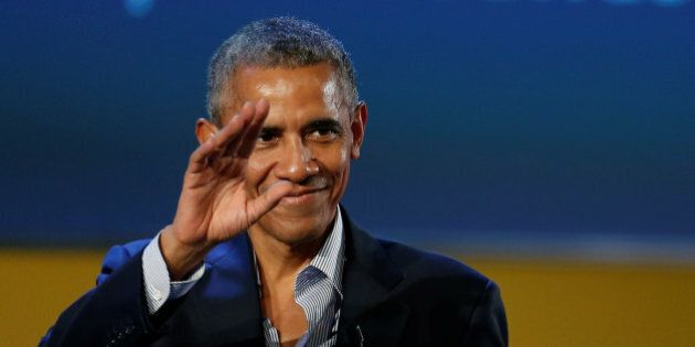Former U.S. President Barack Obama waves after speaking at the Global Food Innovation Summit in Milan,...