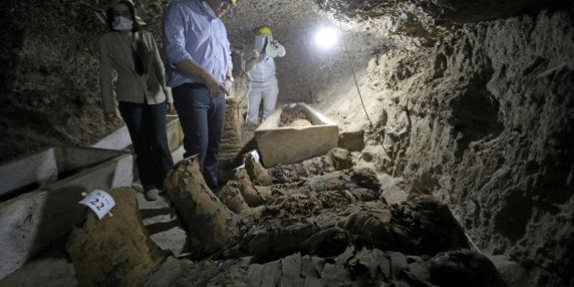Egyptian Minister of Antiquities Khaled Al-Anani inside a newly discovered burial site in Minya, Egypt...