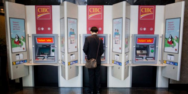 A customer uses an ATM (automated teller machine) at an Canadian Imperial Bank of Commerce (CIBC) branch...