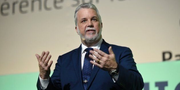 Prime Minister of Quebec Philippe Couillard delivers a speech during the opening of 'Action Day' at the COP21 United Nations conference on climate change in Le Bourget on December 5, 2015. AFP PHOTO / ERIC FEFERBERG / AFP / ERIC FEFERBERG        (Photo credit should read ERIC FEFERBERG/AFP/Getty Images)