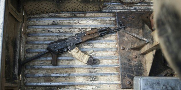 An AK47 machine gun in the back of a military vehicle in Mbalala, Borno State northeast Nigeria on March...