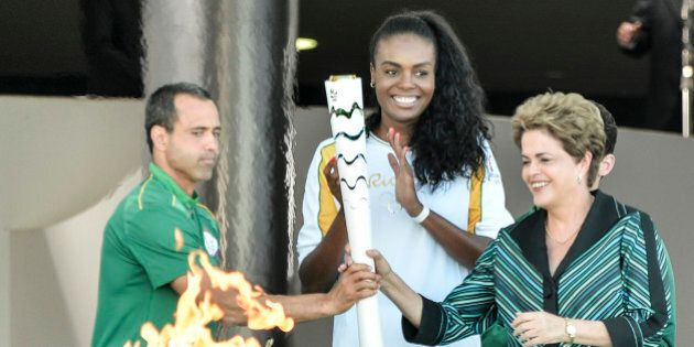 BRASILIA, BRAZIL - MAY 03: Dilma Rousseff President of Brazil receives the Olympic torch at the Palacio...