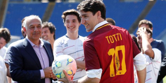 Canada's Prime Minster Justin Trudeau wears an AS Roma's jersey signed by Francesco Totti during the