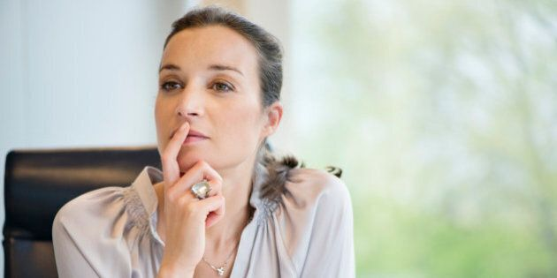 Close-up of a businesswoman thinking in an