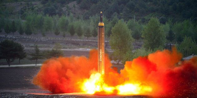 The long-range strategic ballistic rocket Hwasong-12 (Mars-12) is launched during a test in this undated...