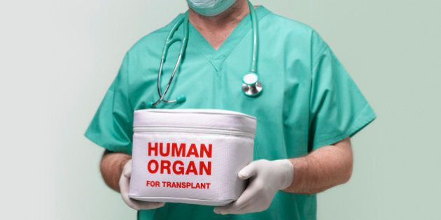 Surgeon with human organ for