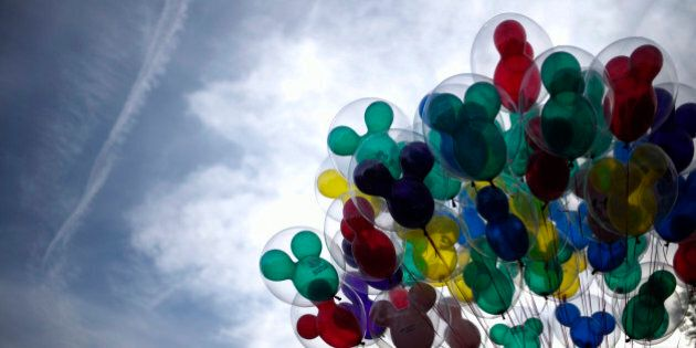 FILE - In this Jan. 22, 2015, file photo, Mickey Mouse shaped balloons are for sale at Disneyland in...