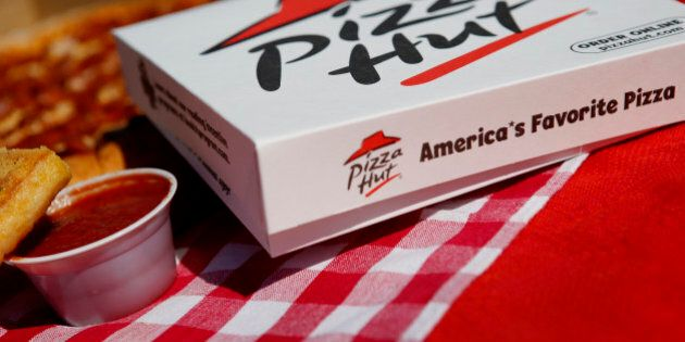 Breadsticks and a pepperoni pizza from a Pizza Hut restaurant, a unit of Yum! Brands Inc., are arranged...