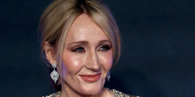 Writer J.K. Rowling poses as she arrives for the European premiere of the