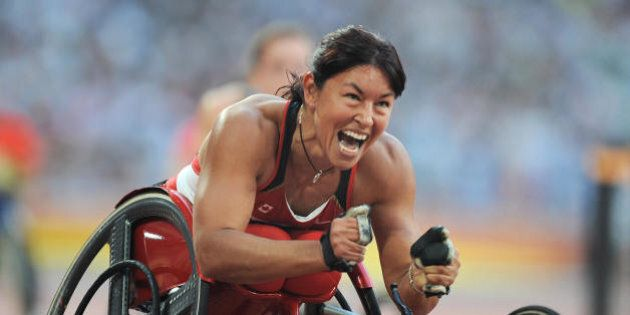 Chantal Petitclerc of Canada celebrates after winning the final of the women's 200 metre T54 classification event at the 2008 Beijing Paralympic Games in Beijing on September 14, 2008. AFP PHOTO/Mark RALSTON (Photo credit should read MARK RALSTON/AFP/Getty Images)