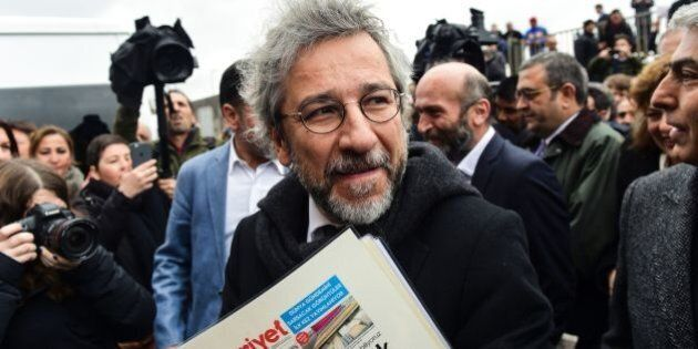Turkish daily Cumhuriyet's editor-in-chief Can Dundar arrives at the Istanbul courthouse before his trial...