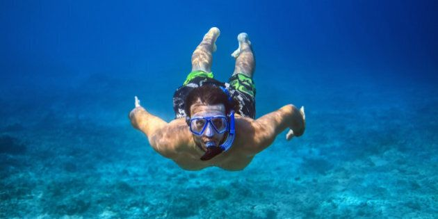 Underwater shoot of a young man snorkeling in a tropical sea. vacation