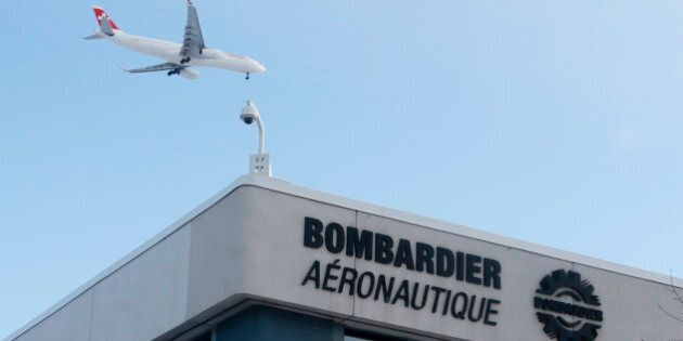 A plane flies over a Bombardier plant in Montreal, Quebec, Canada on January 21, 2014. REUTERS/Christinne...