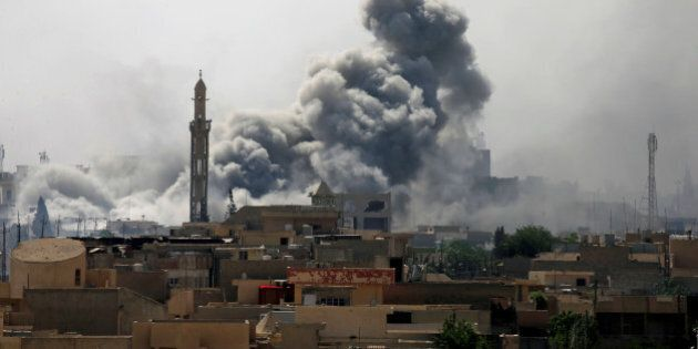 Smoke rises from an airstrike during a battle between Iraqi forces and Islamic State militants in western...
